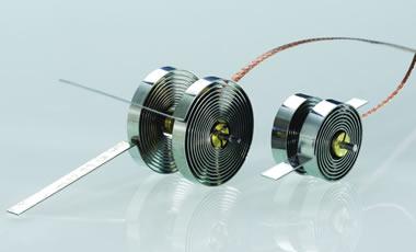 Bimetallfedern werden für temperaturabhängige Stell- und Regelvorgänge eingesetzt.