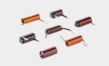 [Translate to Spanish:] Your specialist for enameled copper coils up to 3.5 mm – also with a ferrite core.
