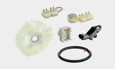 Plastic composite parts & multi-contact wipers